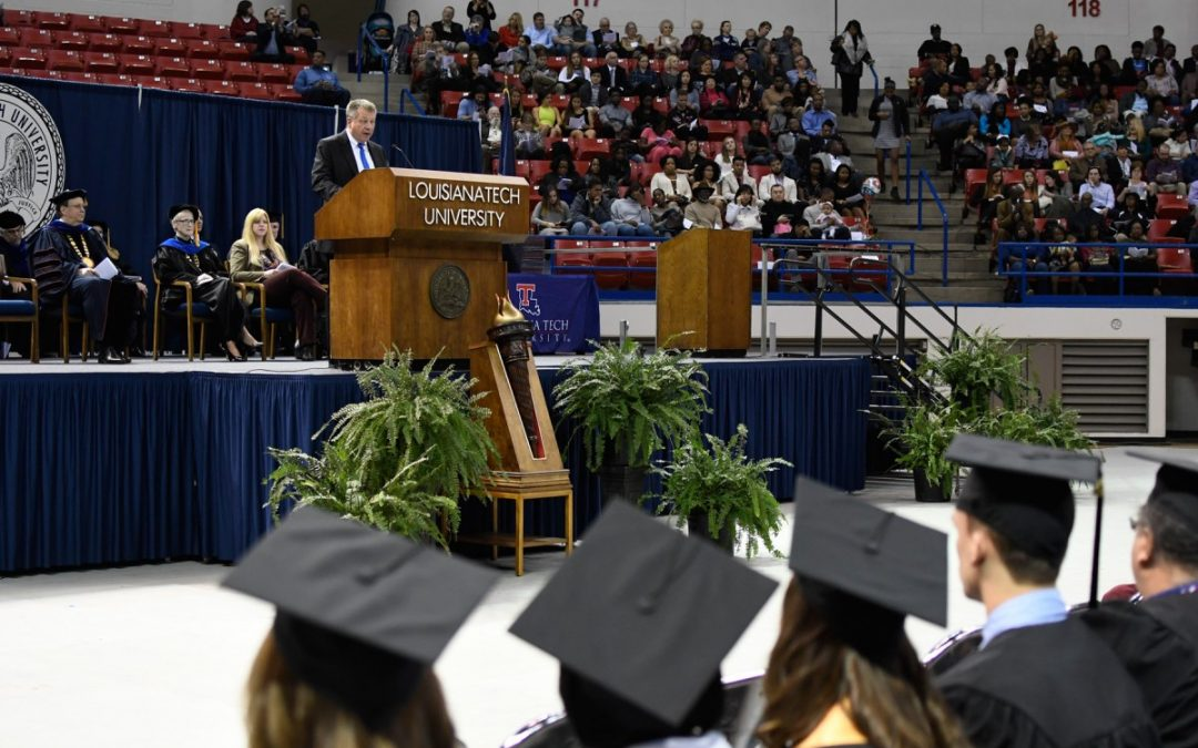 Bill Bradley, SVP of CenturyLink, inspires grads to embrace change
