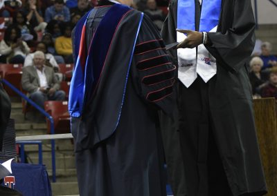 Presenting diploma to Joniah White