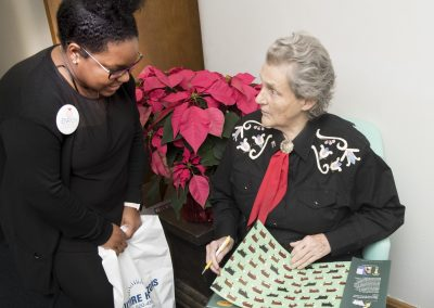 Dr. Temple Grandin signs a copy of The Girl Who Thought in Pictures: The Story of Dr. Temple Grandin for Louisiana Tech student Victoria Ned.
