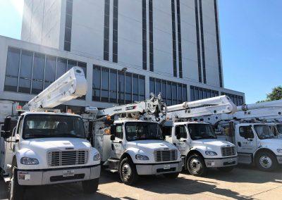Utility trucks at Wyly
